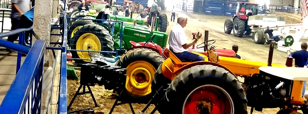 Long row of antique tractors.