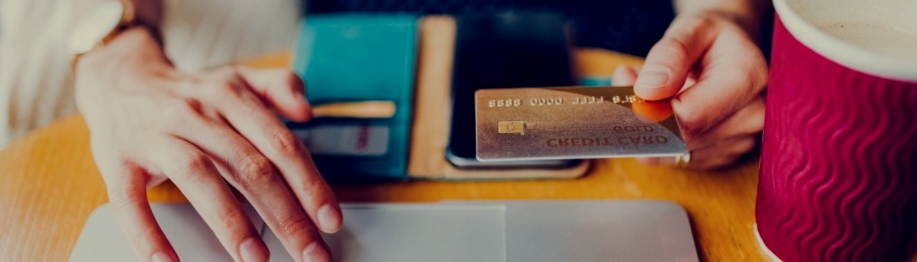 woman with credit card making online purchase - to be used for Personal Credit Card header photo